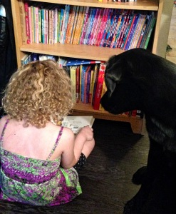 Rock in' the curls while reading to her pup.
